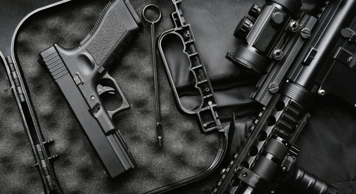 weapons-and-military-equipment-for-army-assault-rifle-gun-m4a1-and-handgun-9mm-on-black-background