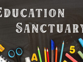 Picture shows a blackboard with the words Education Sanctuary